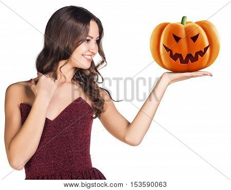 Happy young woman holding carved pumpkin over white background. Halloween concept.
