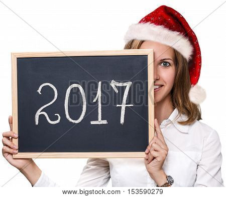 Young woman with xmas red hat showing chalkboard with year date isolated on white