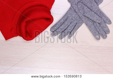 Womanly Clothes On Wooden Background, Copy Space For Text, Clothing For Autumn Or Winter
