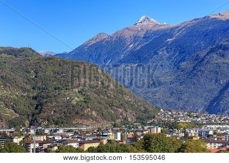View in the city of Bellinzona, Switzerland, mountain Pizzo di Claro (also known as Visagno) in the background. The city of Bellinzona is the capital of the Swiss canton of Ticino.