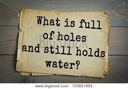 Traditional riddle. What is full of holes and still holds water?