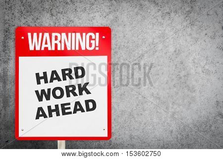 Red Hard work ahead warning sign with copy space. Business concept on Hard work for successful in career. Making a motivative decision on the future by commuting to Hard work.