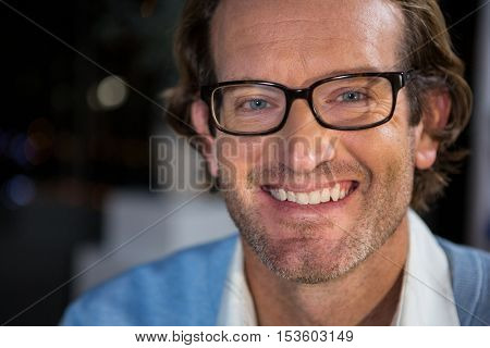 Portrait of businessman in spectacles at office