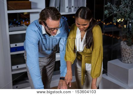 Business executives working in office at night