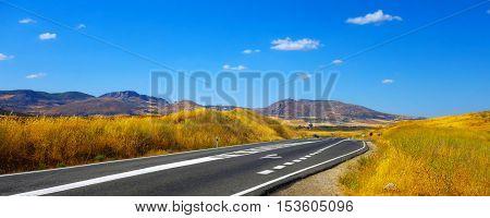 Panoramic view of free motorway in Andalusian nature (Spain).