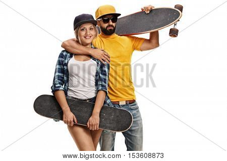 Male skater holding a longboard and a female skater holding a skateboard posing together isolated on white background