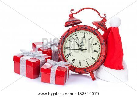 Christmas clock, gift boxes and santa hat. Isolated on white background