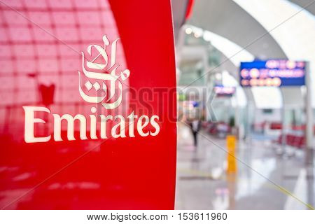 DUBAI, UAE - 31 MARCH, 2014: close us shot of Emirates logo at Dubai International Airport. Emirates is an airline based in Dubai, United Arab Emirates.