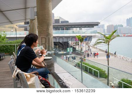 HONG KONG - 06 MAY, 2015: man drink coffee at Starbucks coffee shop in Hong Kong. Starbucks Corporation is an American coffee company and coffeehouse chain.