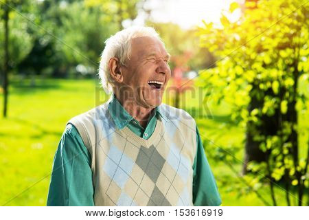 Senior man laughing. Elderly guy outdoor. Modern youth is so funny. Save the sense of humor.