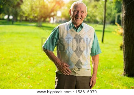 Older man is laughing. Person on background of nature. Funny story about old times. Don't restrain your laughter.