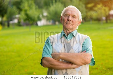 Senior man with crossed arms. Person with serious face. Feel like a boss. Confidence and pride.