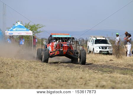 Speeding Red Aceco Rally Car At Start Of Race