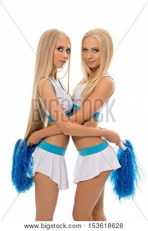 Alluring blondes posing in cheerleading uniforms. Isolated on white