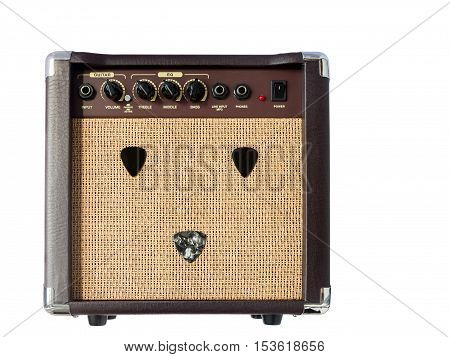 Small acoustic guitar amplifier with pick guitar on amplifier mask isolated on white background