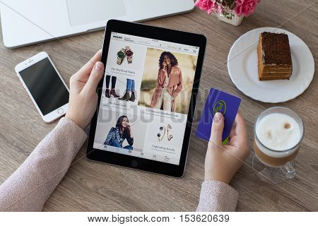 Alushta Russia - October 9 2016: Woman holding a iPad Pro with Internet shopping service Amazon on the screen. iPad Pro 9.7 Space Gray was created and developed by the Apple inc.