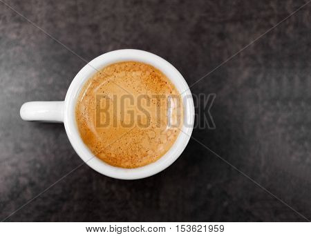 Cup of hot espresso coffee on wood table espresso brew from arabica coffee monotone background