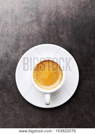 Cup of hot espresso coffee on wood table, espresso brew from arabica coffee, monotone background
