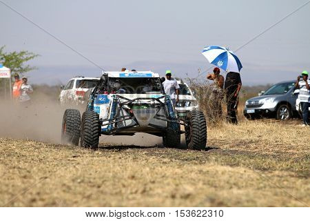 Speeding White Aceco Rally Car Front View