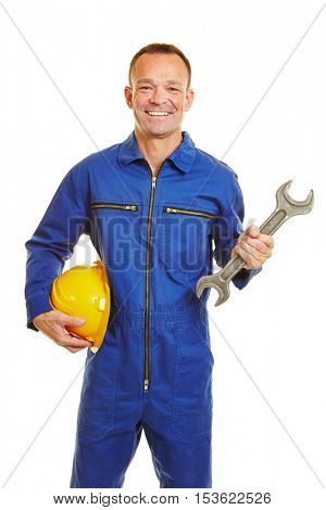 Smiling mechanic worker in jumpsuit with helmet and jaw wrench