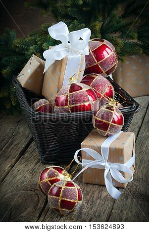 Christmas Card With Red Balls And Boxes In Basket