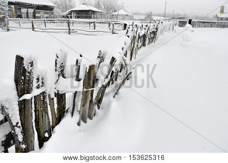 The Rural Fence Covered With Snow