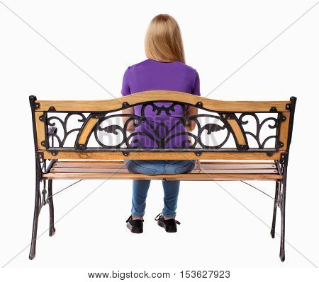 Back view of a woman sitting on a bench.  girl  watching. Rear view people collection.  backside view of person.  Isolated over white background. Lonely girl sitting on the bench.