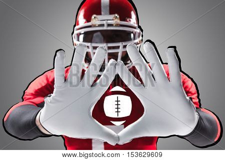The conceptual image of hands of american football player with ball