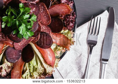 Mediterranean antipasto on a black slate. menu