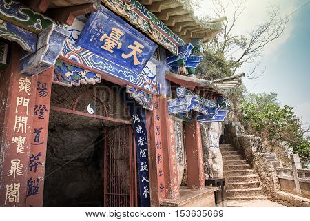 YUNNAN, CHINA-APRIL 2016: Entrance to a cave at the western hill in Yunnan, China built with Chinese traditional architecture