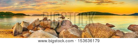 Amazing landscape at sunset. Stones on the foreground. Panorama