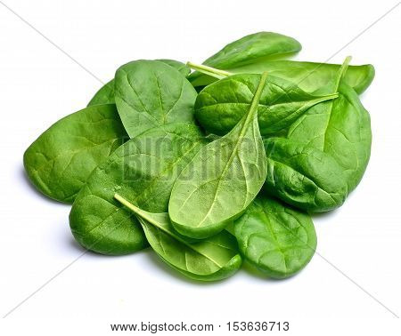 Spinach on white close up isolated .