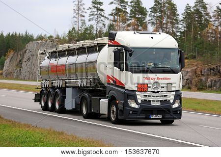 SALO, FINLAND - OCTOBER 21, 2016: Mercedes-Benz Actros semi tank truck of Rueberg Spedition in ADR haul along freeway in South of Finland.