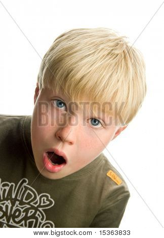 Cute blond boy with surprised expression, isolated on white background