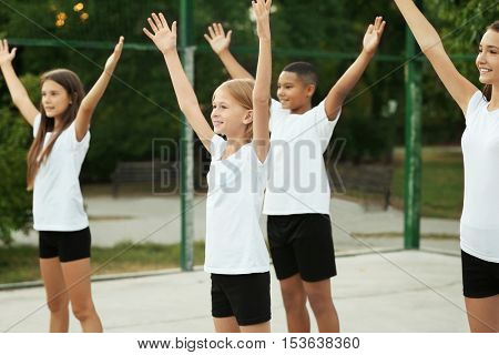 Students doing physical exercises on school yard