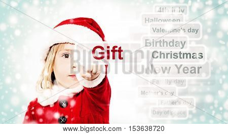 Xmas Child in Santa Hat Surfing through the Internet a Christmas Gift