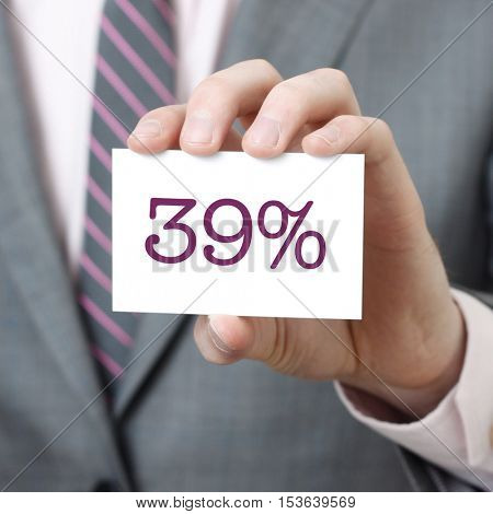 39% written on a card held by a businessman