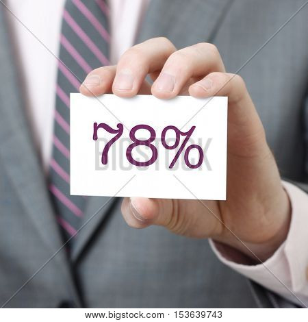 78% written on a card held by a businessman