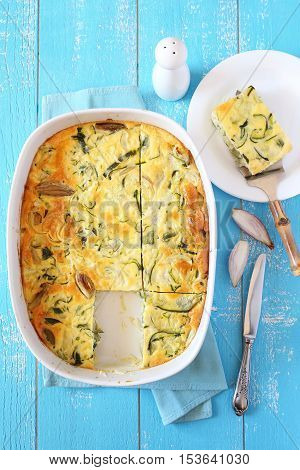Vegetable marrow squash gratin with cheese sour cream and shallot in ceramic bakeware