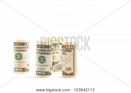 Rolls Dollar banknotes on white background