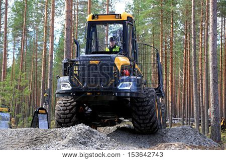 JAMSA FINLAND - SEPTEMBER 2 2016: Ponsse forwarder Buffalo moves ahead steady along bumpy forest floor in a work demo on FinnMETKO 2016.