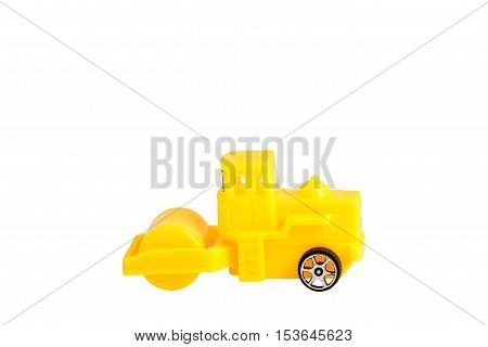 Yellow steamroller toy isolated on white background