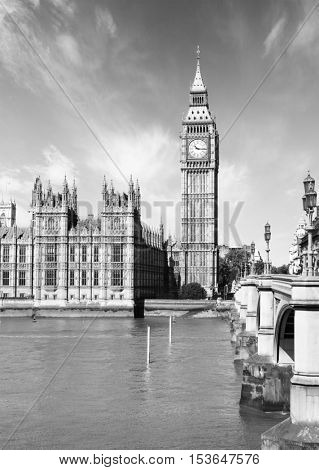 The Palace of Westminster with Elizabeth Tower and Westminster Bridge, London, UK.  Black and White