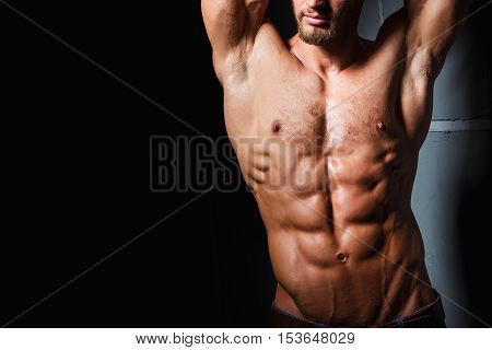 Muscular and sexy torso of young man with perfect abs. Athletic body of young hunk. Fitness concept.
