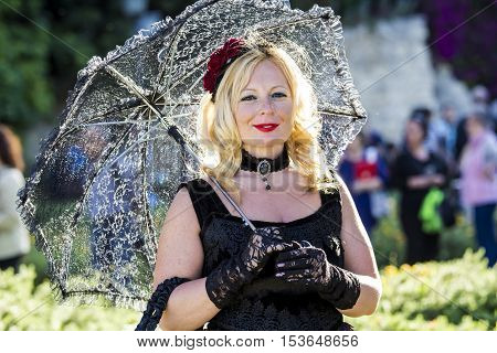 CAGLIARI, ITALY - May 29, 2016: Sunday at La Grande Jatte VIII Ed. At the Public Gardens - Sardinia - portrait of a beautiful woman in Victorian costumes