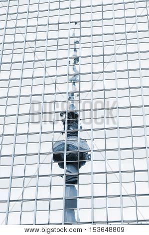 TV Tower in Berlin reflected in the mirrored wall