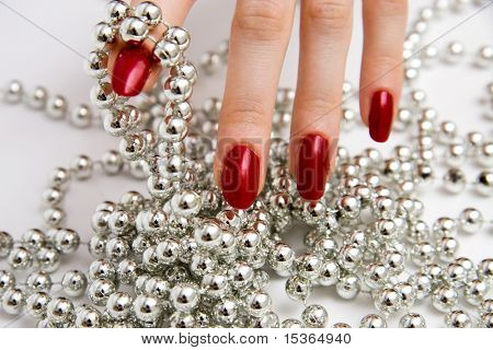Fingers with glass beads.