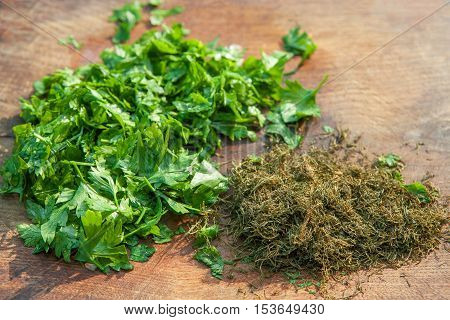 pile of parsley and dill on wooden table