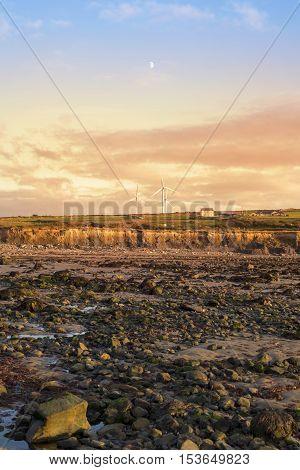 rocky beal beach near ballybunion on the wild atlantic way ireland with a beautiful yellow sunset