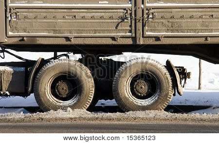 Dirty truck. Winter on Moscow streets.